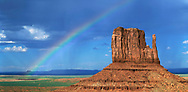 A Rainbow Over The Left Mitten At Monument Valley Tribal Park, Arizona, USA
