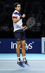 Pierre-Hugues Herbert celebrates winning the second set during his doubles match against Horia Tecau and Jean-Julien Rojur during day one of the NITTO ATP World Tour Finals at the O2 Arena, London.
