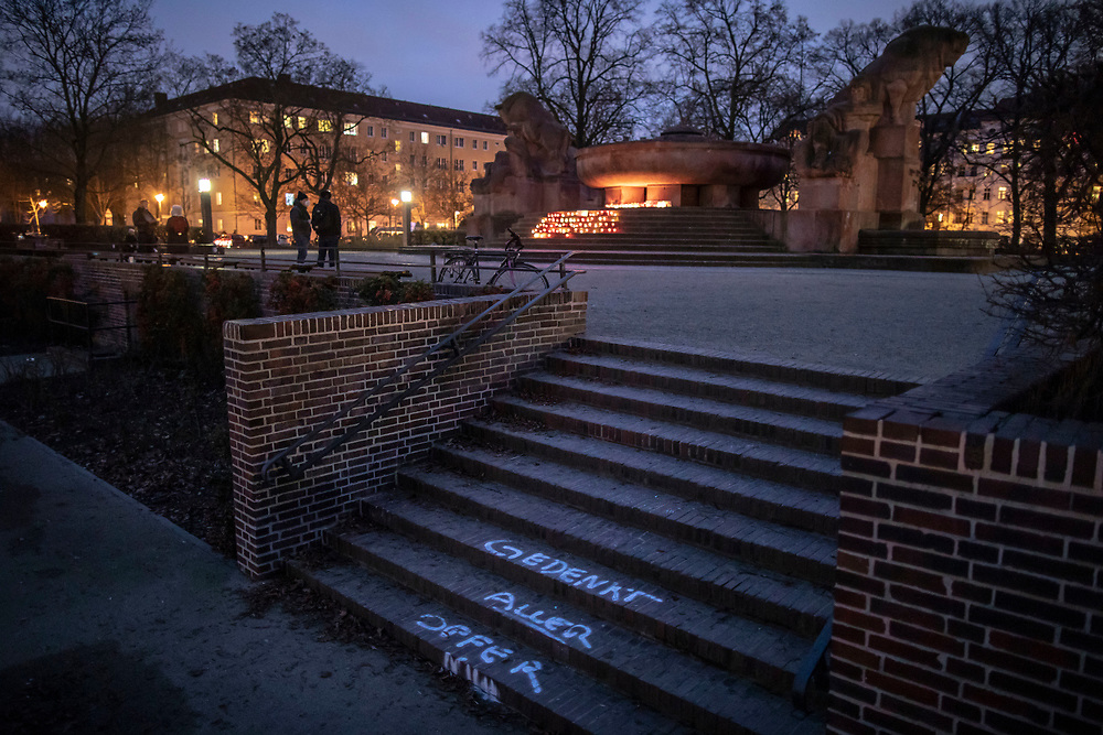 """at  Arnswalder Platz in Berlin, Germany, January 17,  2021. The memorial is part of the initiative  """"Corona-Tote sichtbar machen"""" (lit. Make corona deaths visible) by Christian Y. Schmidt and Veronika Radulovic,  since December 6, 2020, people gather at the fountain of Arnswalder Platz every Sunday at 16:00, light candles and place placards with the current death toll reported in Germany at the time. The death toll in Germany by variouse sources revolved around 47,000."""
