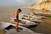 Hindu men at Rana Ghat  by the Ganges river in Varanasi, India.