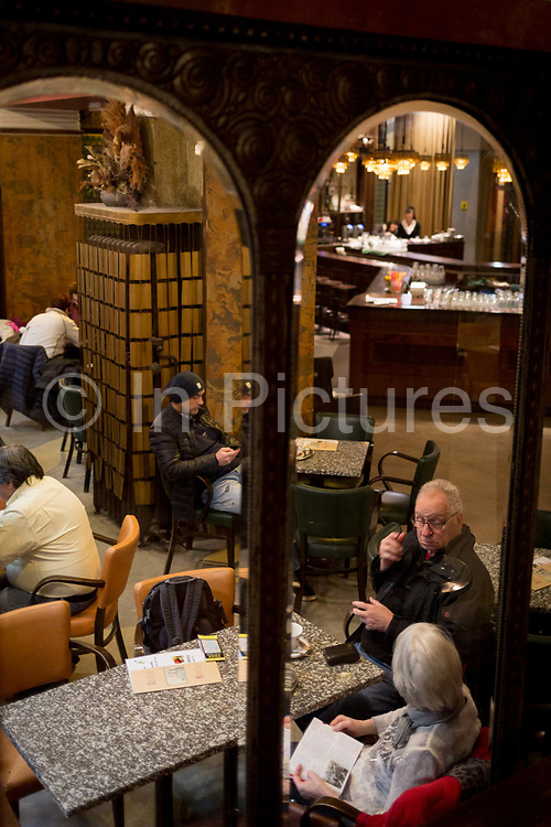 Prague citizens relax in Cafe Lucerna, on 19th March, 2018, in Prague, the Czech Republic. The most elegant of Nove Mesto's many shopping arcades runs through the art-nouveau Lucerna Palace 1920, between Stepanska and Vodickova streets. The complex was designed by Václav Havel grandfather of the former president, and is still partially owned by the family. It includes theatres, a cinema, shops, a rock club and several cafes and restaurants.