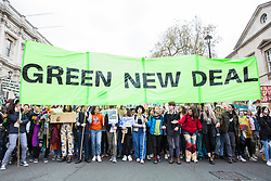 London, UK. 12th April 2019. Students take part in the third Youth Strike 4 Climate. After gathering in Parliament Square, students marched through central London to occupy Oxford Circus. The strike was organised by UK Student Climate Network and the UK Youth Climate Coalition to demand that the Government declare a climate emergency and take positive steps to address the climate crisis.