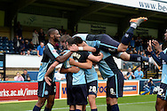Michael Harriman of Wycombe Wanderers celebrates after scoring his sides first goal to make it 1-0 with Luke O'Nien of Wycombe Wanderers and his teammates. Skybet football league two match, Wycombe Wanderers v Hartlepool Utd at Adams Park in High Wycombe, Bucks on Saturday 5th Sept 2015.<br /> pic by John Patrick Fletcher, Andrew Orchard sports photography.