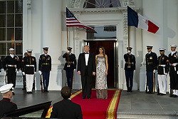 April 24, 2018 - Washington, District of Columbia, United States of America - United States President Donald J. Trump and first lady of the United States Melania Trump emerge from the White House as the await the arrival of French President Emmanuel Macron and first lady of France Brigette Macron prior to the State Dinner during the French State Visit to the United States on April 24, 2018 in Washington, DC. Credit: Alex Edelman / Pool via CNP (Credit Image: © Alex Edelman/CNP via ZUMA Wire)