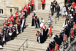 Queen Elizabeth II walks down the steps to her carriage during the annual Order of the Garter Service at St George's Chapel, Windsor Castle.