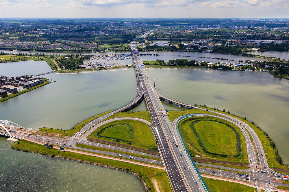 Nederland, Noord-Holland, Amsterdam, 14-06-2012; ring A10, Zeeburgerbrug en afslag S114 op het Zeeburger eiland, links IJburg..Zeeburgerbrug (bridge) with the A10 Ringroad connecting the the North and South of Amsterdam..luchtfoto (toeslag), aerial photo (additional fee required).foto/photo Siebe Swart