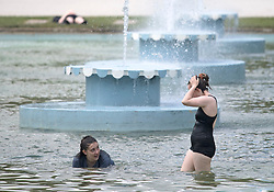 © Licensed to London News Pictures. 10/06/2021. London, UK. Members of the public cool off in the fountains at Battersea Park in south London on another warm summer day. . Photo credit: Ben Cawthra/LNP