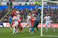 Andre Ayew of Swansea city © scores his teams 1st goal with a header. Barclays Premier league match, Swansea city v Liverpool  at the Liberty Stadium in Swansea, South Wales on Sunday 1st May 2016.<br /> pic by  Andrew Orchard, Andrew Orchard sports photography.