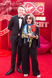 EDITORIAL USE ONLY<br /> Caitlin Moran with Virgin TV's red-carpet host Roman Kemp in Virgin TV's Must-See Moment Lounge at the Virgin TV British Academy Television Awards.