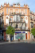 Historic buildings in Plaza del Altozano, Triana district, Seville, Spain, glass-fronted balconies called miradores