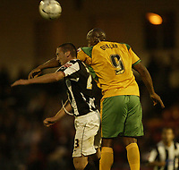 Photo: Aidan Ellis.<br /> Rochdale v Norwich City. Carling Cup. 28/08/2007.<br /> Norwich's Dion Dublin challenges Rochdale's Tom Kennedy