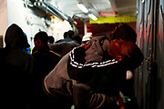 Migrants embrace on the deck of MV Aquarius, a search and rescue ship run in partnership between SOS Mediterranee and Medecins Sans Frontieres, after being rescued in the central Mediterranean, 69 nautical miles off the coast of Libya, December 15, 2017. REUTERS/Darrin Zammit Lupi     TPX IMAGES OF THE DAY - RC1FE3186560