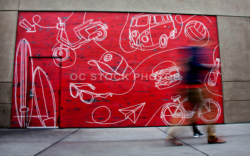 Red Painted Wall Mural With White Drawings at Pacific City Huntington Beach