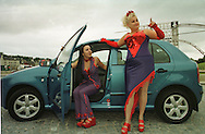 TV favourites Supergirly (Jai Simeone, left and Louise McClatchy) arrive outside Our Dynamic Earth in Edinburgh where they were warming up for Sunday's Skoda Fringe Gala. Other celebrities who will be appearing include Boy George and Lady Salsa and Kylie Minogue. ....