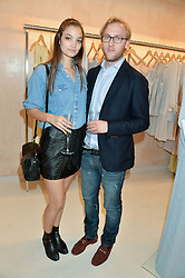 EMORY AULT and HARRY OSBORNE at a party to celebrate the re-launch of the Ghost Flagship store at 120 King's Road, London on 15th April 2015.