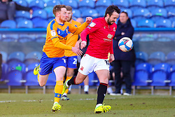 Stephen Quinn of Mansfield Town chases down Aaron Wildig of Morecambe - Mandatory by-line: Ryan Crockett/JMP - 27/02/2021 - FOOTBALL - One Call Stadium - Mansfield, England - Mansfield Town v Morecambe - Sky Bet League Two
