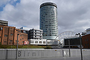 The iconic Rotunda building near New Street Station in Birmingham city centre is virtually deserted due to the Coronavirus outbreak on 31st March 2020 in Birmingham, England, United Kingdom. Following government advice most people are staying at home leaving the streets quiet, empty and eerie. Coronavirus or Covid-19 is a new respiratory illness that has not previously been seen in humans. While much or Europe has been placed into lockdown, the UK government has announced more stringent rules as part of their long term strategy, and in particular social distancing.