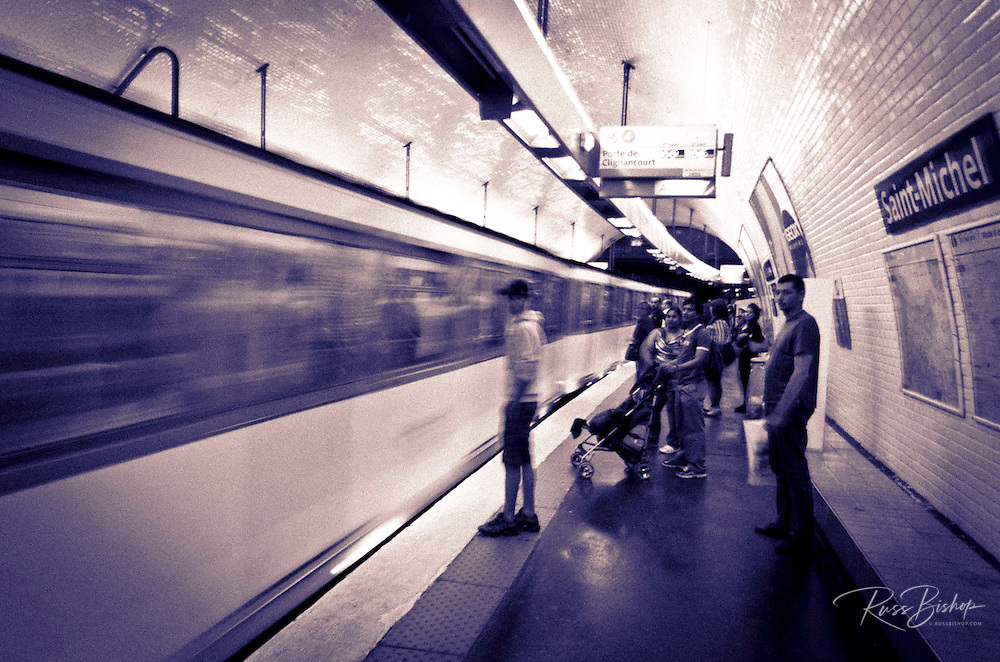 Metro station and passing train, Paris, France