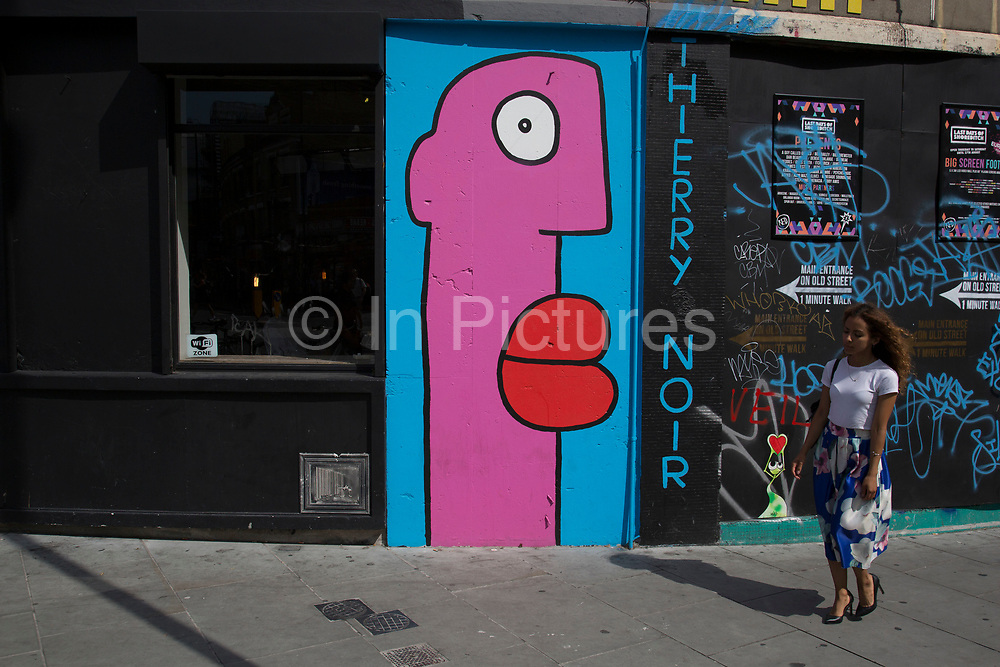 Street art by Thierry Noir in Shoreditch, East London, United Kingdom. Street art in the East End of London is an ever changing visual enigma, as the artworks constantly change, as councils clean some walls or new works go up in place of others. While some consider this vandalism or graffiti, these artworks are very popular among local people and visitors alike, as a sense of poignancy remains in the work, many of which have subtle messages. (photo by Mike Kemp/In Pictures via Getty Images)