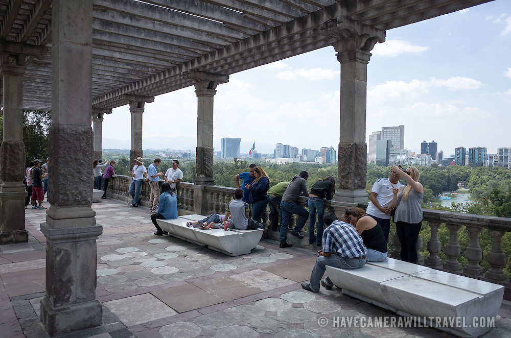 Tourists enjoy the view overlooking Chapultepec Forest from Chapultepec Castle. Since construction first started around 1785, Chapultepec Castle has been a Military Academy, Imperial residence, Presidential home, observatory, and is now Mexico's National History Museum (Museo Nacional de Historia). It sits on top of Chapultepec Hill in the heart of Mexico City.