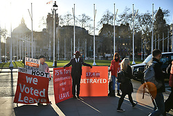 © Licensed to London News Pictures. 25/03/2019. London, UK. Pro Brexit protestors gather outside the Houses of Parliament in London ahead of a series of votes on Brexit by MPs this evening. There have been reports of a cabinet revolt against Prime Minister Theresa May, over her handing of the Brexit negotiations. Photo credit: Ben Cawthra/LNP