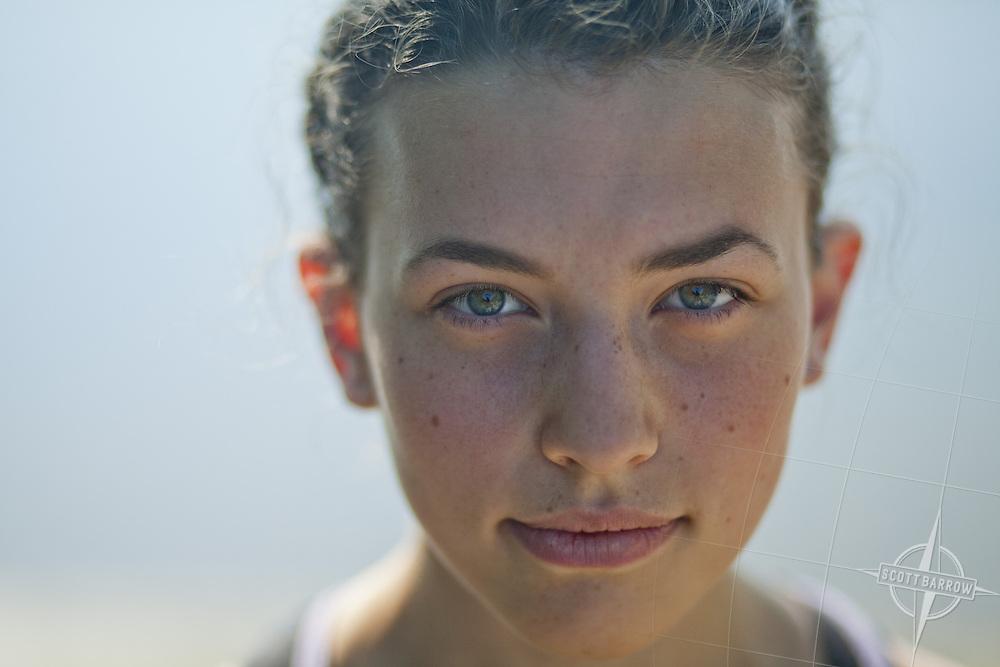 Portrait of twenty year old woman alone lake-side.