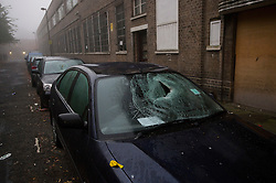© Licensed to London News Pictures. 01/11/2015. London, UK. Damage to vehicles caused by rioting at The scene where Riot police clashed with party goers at the site of an illegal halloween rave in London where it has been reported that a petrol bomb was thrown. Photo credit: Ben Cawthra/LNP