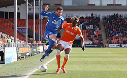 Jason Naismith of Peterborough United in action with Armand Gnanduillet of Blackpool - Mandatory by-line: Joe Dent/JMP - 13/04/2019 - FOOTBALL - Bloomfield Road - Blackpool, England - Blackpool v Peterborough United - Sky Bet League One