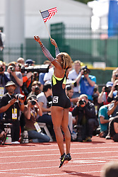 Sanya Richards-Ross, Women's 400 meters, champion, Olympian, jumps and waves American flag after winning