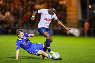 Colchester United midfielder Tom Lapslie (4) slides in to tackle Tottenham Hotspur midfielder Victor Wanyama (12) during the EFL Cup match between Colchester United and Tottenham Hotspur at the JobServe Community Stadium, Colchester, England on 24 September 2019.