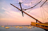 The tall ship Mayflower II with boats in the harbor at Plymouth Rock State Park in Plymouth, MA in August of 2004
