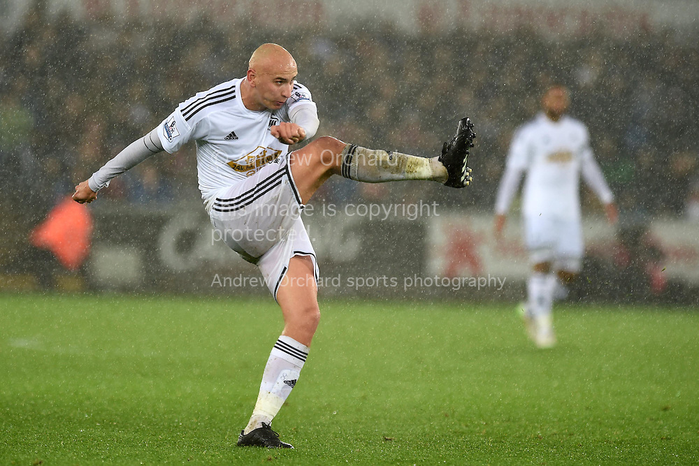 Jonjo Shelvey of Swansea city has a shot. Barclays Premier league match, Swansea city v Aston Villa at the Liberty stadium in Swansea, South Wales on Boxing Day, Friday 26th December 2014<br /> pic by Andrew Orchard, Andrew Orchard sports photography.