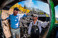 Governor John Hickenlooper (of Colorado) riding in the steam locomotive with the train engineer and fireman on a visit to the the Cumbres & Toltec Scenic Railroad, from Antonito to Osier, Colorado during peak autumn color. The Cumbres & Toltec Scenic Railroad has been jointly owned by the States of Colorado and New Mexico since 1970 when it was purchased from the Denver and Rio Grande Western Railway, which was going to scrap the line. The train makes a 64 mile run between Antonito, Colorado and Chama, New Mexico. The railroad is the highest and longest narrow gauge steam railroad in the United States with a track length of 64 miles. The train traverses the border between Colorado and New Mexico, crossing back and forth between the two states 11 times. The narrow gauge track is 3 feet wide. It runs over 10,015 ft (3,053 m) Cumbres Pass.