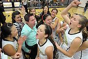 The Calabasas girls' basketball team celebrates their overtime win against Santa Barbara on February 23, 2013.