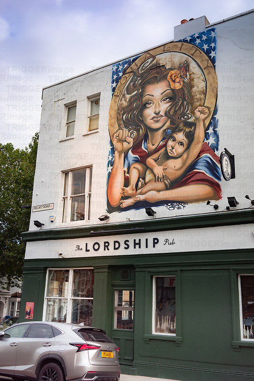 Mural painted on street wall in Dulwich south London