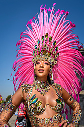 © Licensed to London News Pictures. 26/08/2019. LONDON, UK. A dancer takes part in the Grand Finale at the Notting Hill Carnival.  Over one million revellers are expected to visit Europe's biggest street party over the Bank Holiday Weekend in a popular annual event celebrating Caribbean culture.  Photo credit: Stephen Chung/LNP