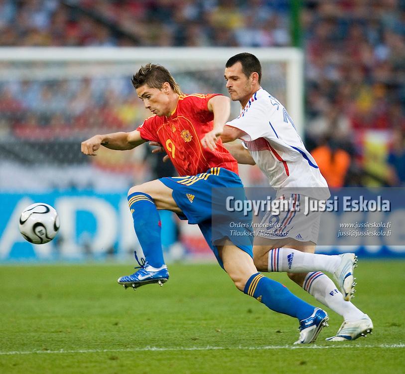 Fernando TORRES, Willy SAGNOL.&#xA;Spain - France, World Cup. Hanover, Germany, June 27, 2006.&#xA;Photo: Jussi Eskola<br />