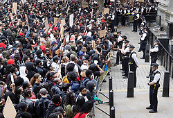 © Licensed to London News Pictures. 03/06/2020. London, UK. Black Lives Matter protesters stand outside the gates of Downing Street in Whitehall during a demonstration following the death of African American George Floyd while in police custody. The death of George Floyd, who died after being restrained by a police officer In Minneapolis, Minnesota, has caused widespread rioting and looting across the USA. Photo credit: Peter Macdiarmid/LNP