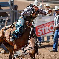 080515       Cable Hoover<br /> <br /> McKyle Wilson struggles to stay in the saddle during the saddle bronc competition of the IJRA rodeo Wednesday at Red Rock Park in Gallup.