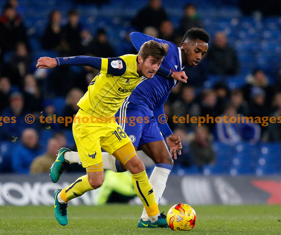 Oxford's Joe Rottweil fends off Chelsea's Mukhtar Ali during the Checkatrade Trophy match between Chelsea U21's and Oxford United at Stamford Bridge in London. November 8, 2016.<br /> Carlton Myrie / Telephoto Images<br /> +44 7967 642437