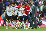 Manchester United celebrate winning the FA Cup during the The FA Cup Final between Crystal Palace and Manchester United at Wembley Stadium, London, England on 21 May 2016. Photo by Phil Duncan.