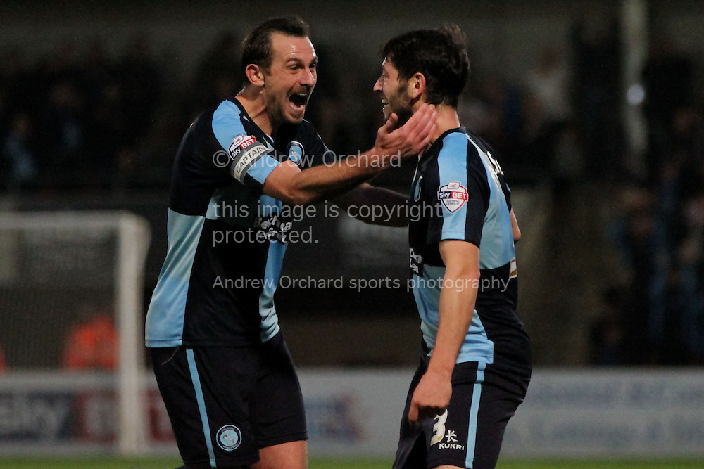 Joe Jacobson of Wycombe (right) is congratulated by his captain Paul Hayes after scoring his side's third goal. Skybet football league two match, Cheltenham Town  v Wycombe Wanderers at The Abbey Business Stadium, Whaddon Road in Cheltenham, Glos on Saturday 22nd November 2014.<br /> pic by Mark Hawkins, Andrew Orchard sports photography.