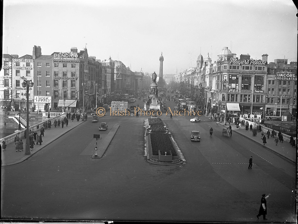 Views of O' Connell Bridge, O' Connell Street, Dublin. 07/01/58,<br /> <br /> View of O'Connell Street, Dublin (Irish Baile Atha Cliath), capital and largest city of the Republic of Ireland (Eire, Ireland) at the east coast and the mouth of the river Liffey at Dublin Bay. O'Connell Monument, the memorial to Daniel O'Connell, 19th century nationalist leader, by sculptor John Henry Foley which stands at the entrance to the street named after him.The Nelson Pillar known locally as Nelson's Pillar or simply The Pillar, was a large granite pillar topped by a statue of Horatio Nelson in the middle of O'Connell Street (formerly Sackville Street) in Dublin. It was built in 1808-1809 and was destroyed by a bomb planted by Irish Republicans in 1966.