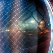 Fisheye lens use looking into highway overpass fence glass to see what kind of light reflections from other directions are made apparent. Taken from Truman and Grand looking eastward, Kansas City, Missouri.