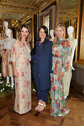 Left to right, OLGA VILSHENKO, ALEX EAGLE and PIPPA VOSPER at the Vilshenko Mid-Summer Cocktail Party held at the Cafe Royal, 68 Regent Street, London on 20th June 2014.