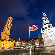 The Markt (Market Square) in the historic center of Bruges, a UNESCO World Heritage site. At left is the Belfry bell tower. At right is the statue of Jan Breydel and Pieter de Coninck, two Flemish heroes from the early 14th century.