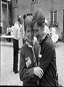Irish Scout Jamboree .at Portumna Co Galway.1985..31.07.1985.07.31.1985.31st July 1985..The President Dr Patrick Hillery officially opened The Irish Scout Jamboree. The President,who arrived by helicoptor,was greeted by Camp Chief, Michael Webb, and a guard of honour of senior scouts. Amoung the invited guests from church and State was Mr Nicholas Scott,the Northern Ireland Office, Minister for Education..Ten thousand scouts took part in the jamboree. The Jamboree was a first in that for the first time the three scouting organisations within Ireland came together. The Scout Association of Ireland,The Catholic Boy Scouts of Ireland and The Northern Ireland Scout Council..Image shows that scouting is not only for boys as Cliona and Cormac share a hug.
