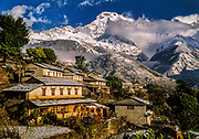 Gandrung village after morning snowfall, Annapurna South above near Annapurna sanctuary, Nepal Himalaya