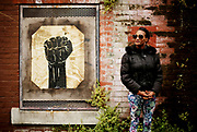 """Khalilah Mitchell stands for a portrait, Friday, June 15, 2018, in San Francisco, Calif. Mitchell is a native of San Francisco's Fillmore neighborhood and finds inspiration in the election of London Breed: """"A chick from the hood got elected mayor. That means anything is possible."""""""