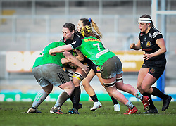 Ebony Jefferies of Exeter Chiefs is tackled by Chloe Edwards and Emily Robinson of Harlequins - Mandatory by-line: Andy Watts/JMP - 06/02/2021 - Sandy Park - Exeter, England - Exeter Chiefs Women v Harlequins Women - Allianz Premier 15s